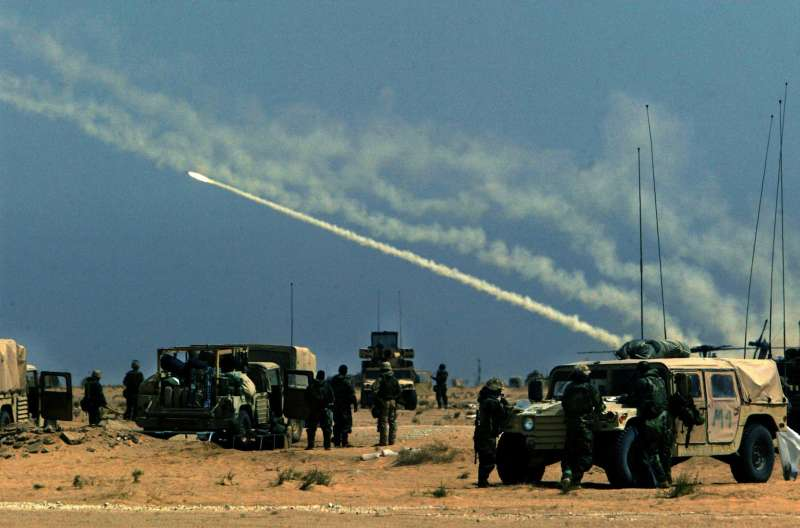 Troops watch a rocket fired from MLRS (Multiple Launch Rocket System) take off somewhere in the Iraq desert. Photo by: David Leeson/The Dallas Morning News