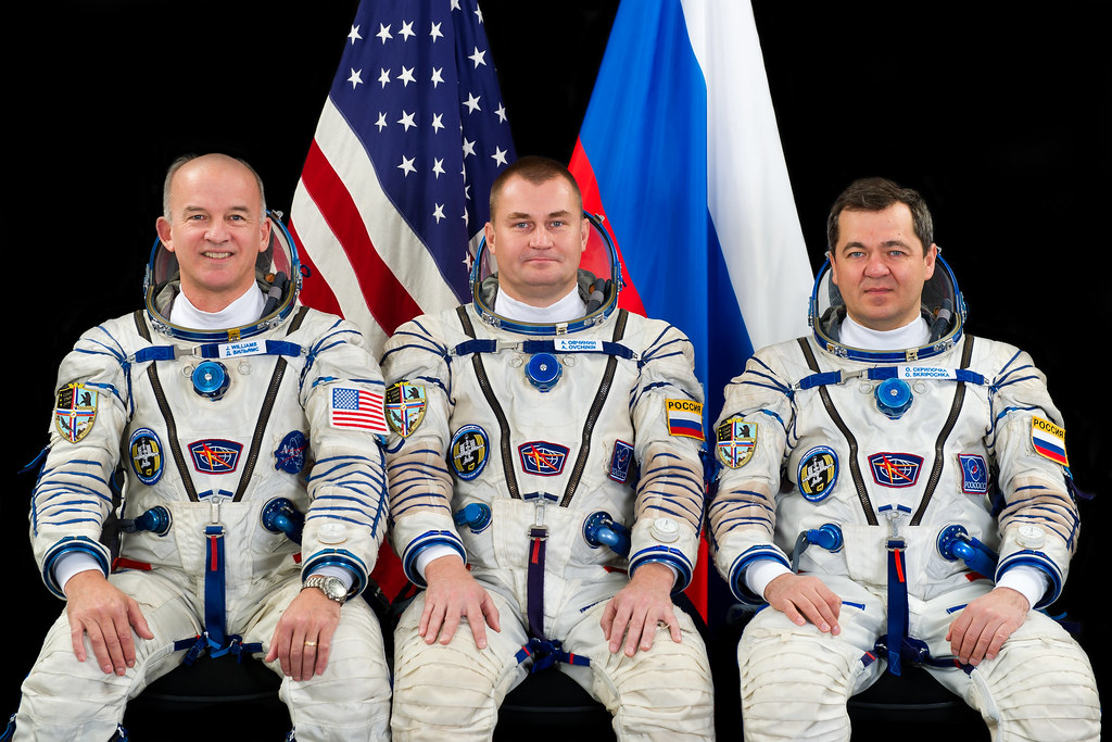 Российские и американский космонавты